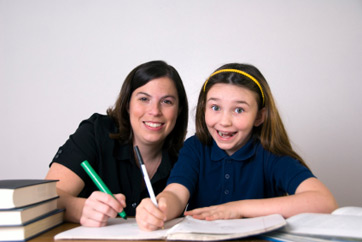 Student and teacher writing
